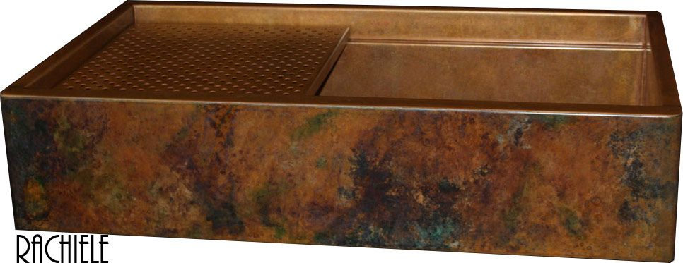 Rustic patina on a copper farmhouse workstation apron sink