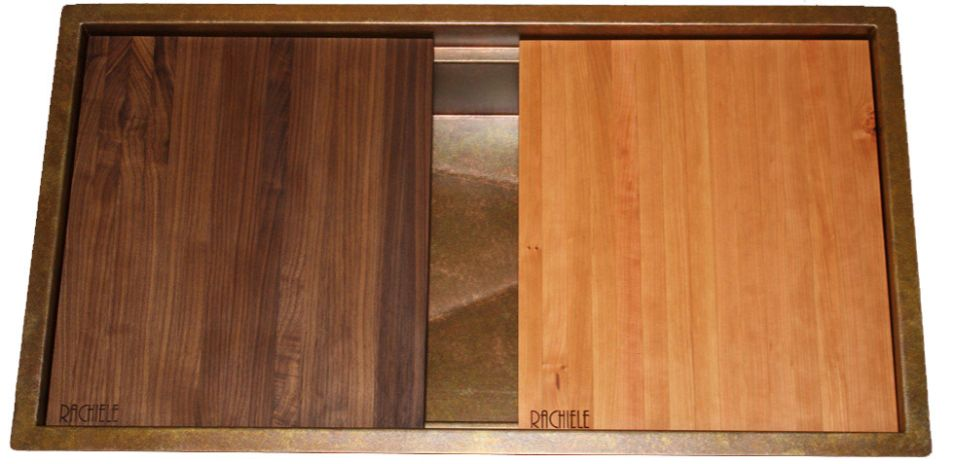 cherry and walnut cutting boards on workstation copper sink