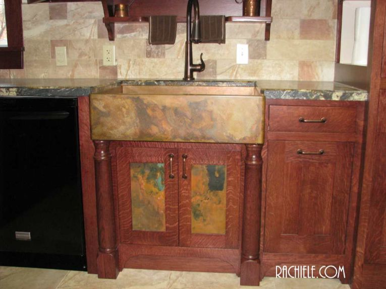 copper door panels below copper farmhouse sink