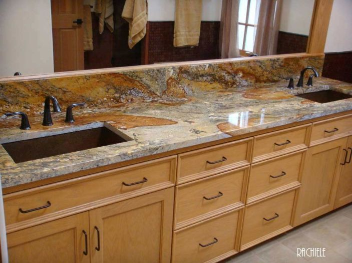 two copper lavatory sinks in marble top