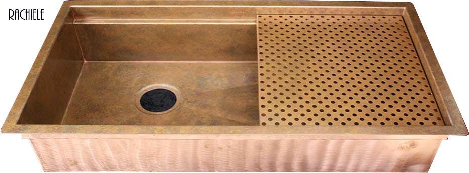 copper under mount sink with cutting board and grid