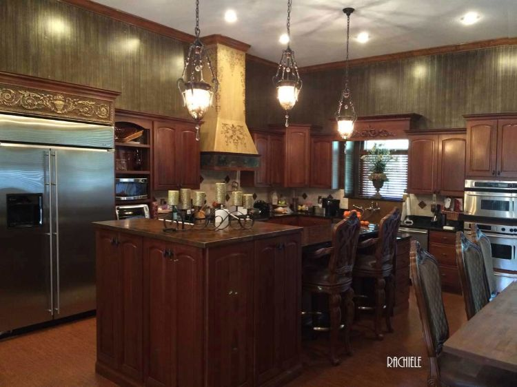 ornate kitchen with copper hood and countertop