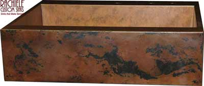 custom copper farmhouse sink with black and brown patina