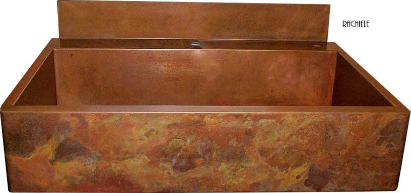 copper farmhouse sink with rear deck and backsplash