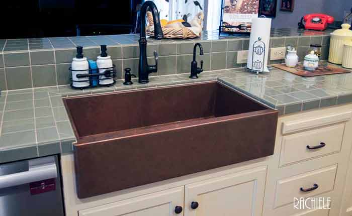 copper under mount farmhouse sink with tile counter top