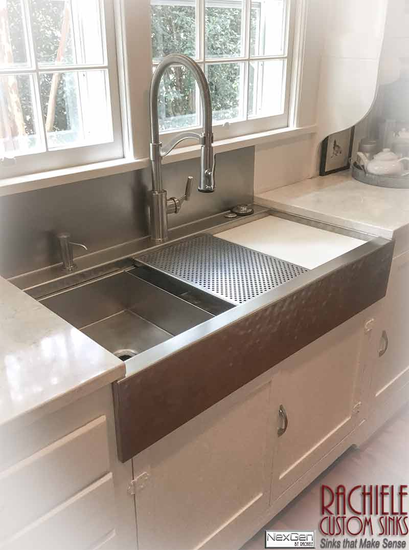 stainless steel farmhouse sink with integral backsplash and faucet deck. Hammered stainless farm sink.