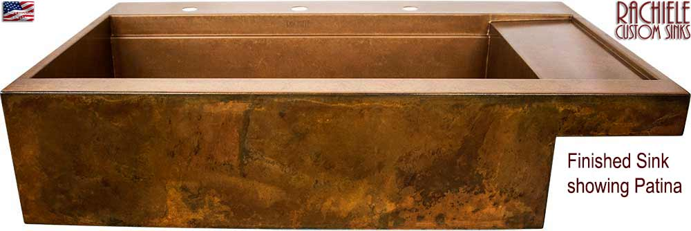 custom copper workstation farm sink with drainboard finished with patina