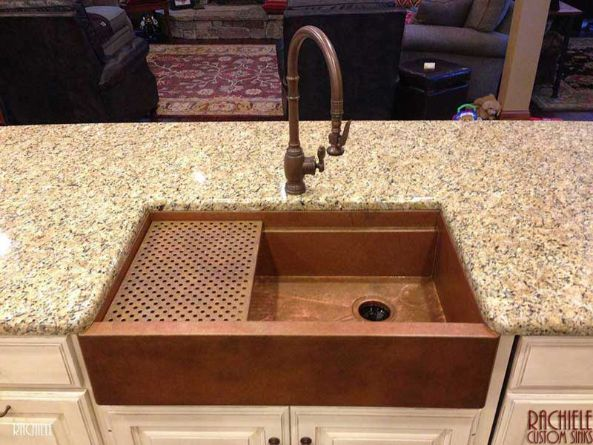 copper farmhouse workstation sink with copper grid