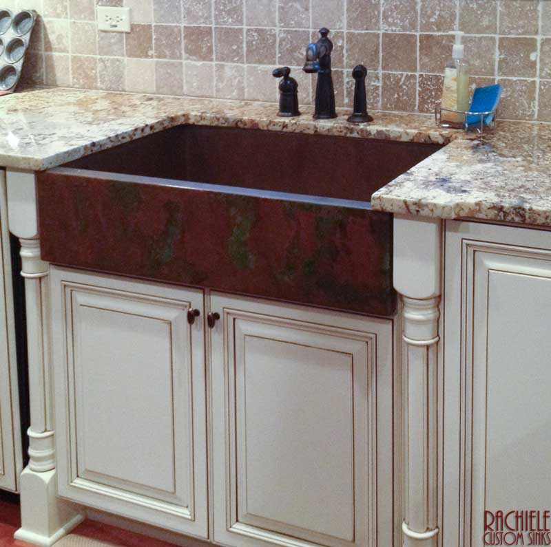 Copper under mount kitchen sink with a Waterstone 5600 and soap dispenser in American Bronze