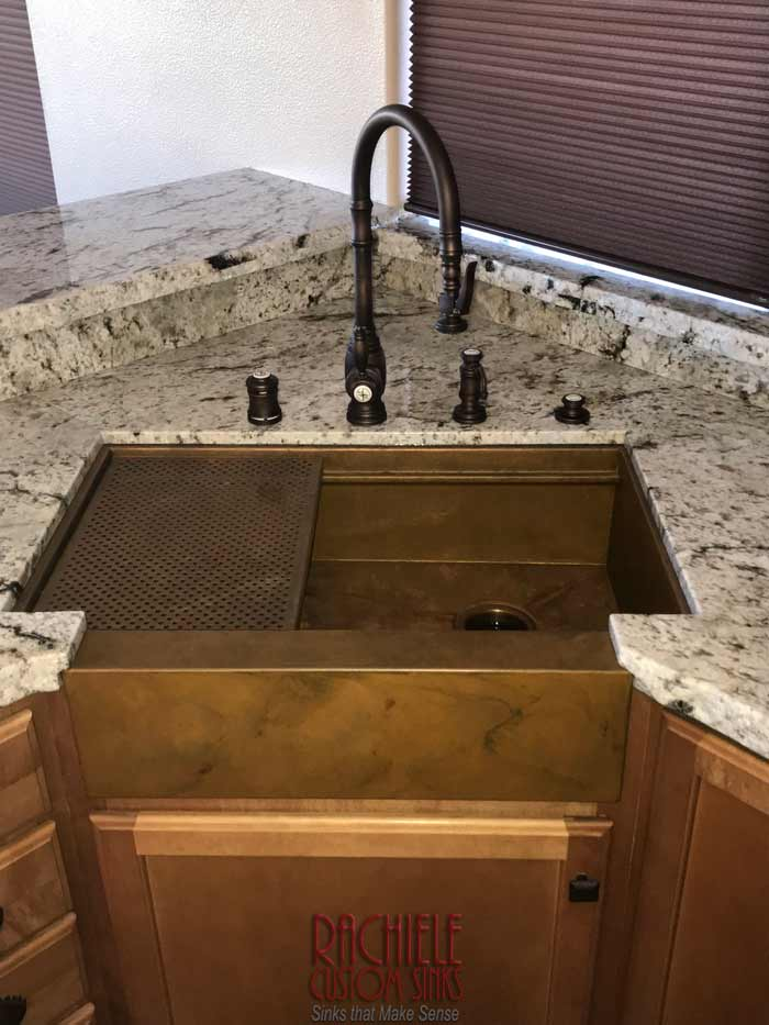 Copper Corner Apron Front Farm Sink with larger bowl. Custom Designed to maximize bowl size.