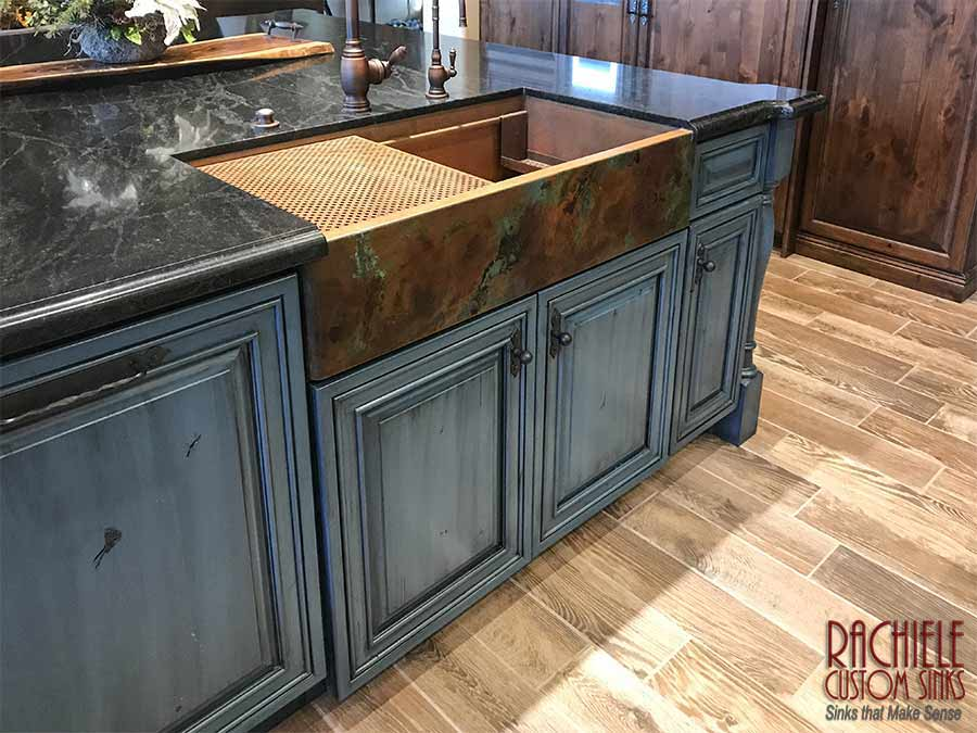 copper farm sink with beautiful patina in blue cabinet kitchen