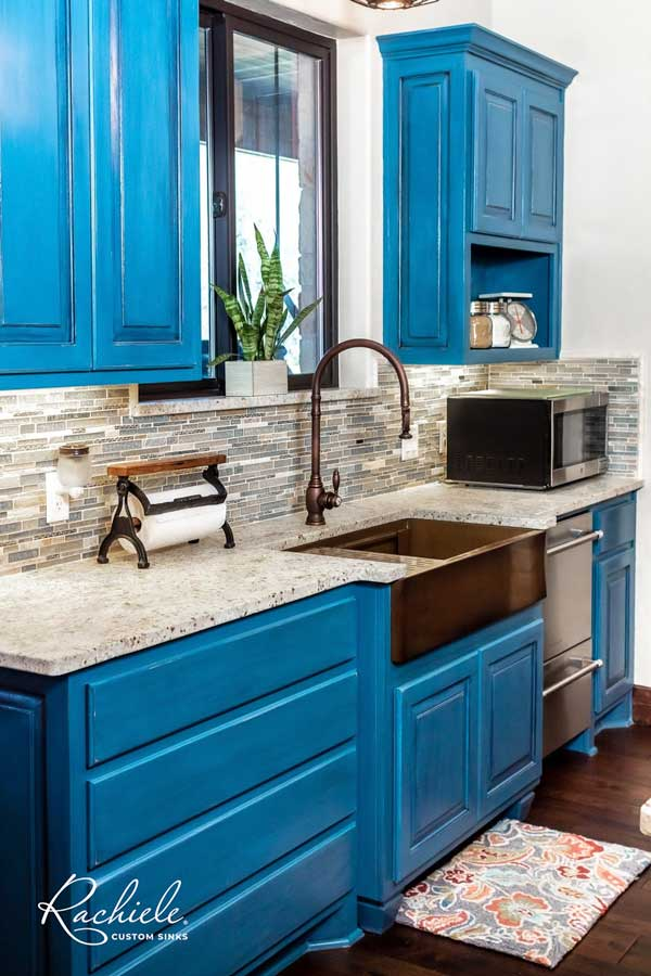 Blue kitchen with copper farm sink