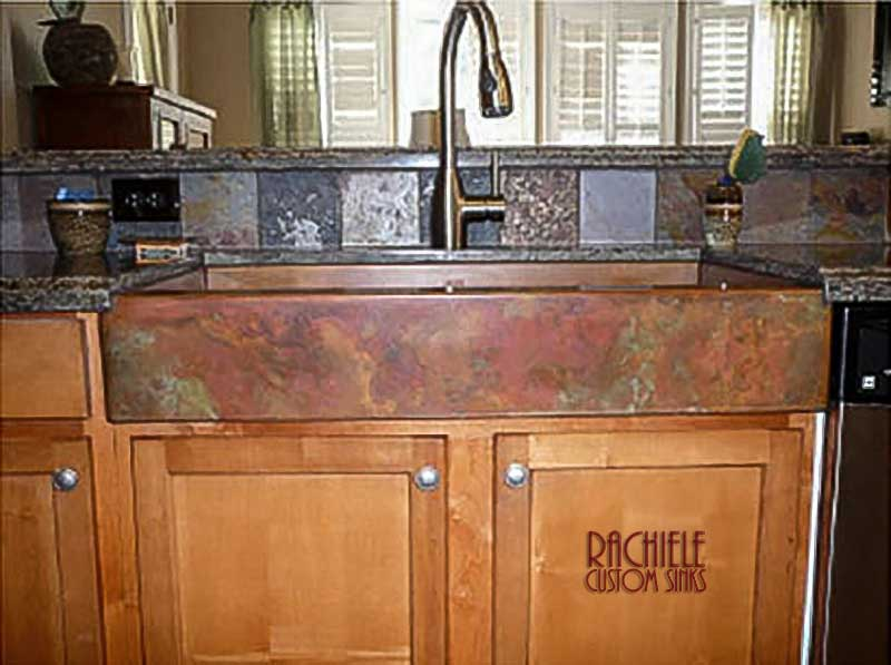copper farmhouse sink with colorful patina
