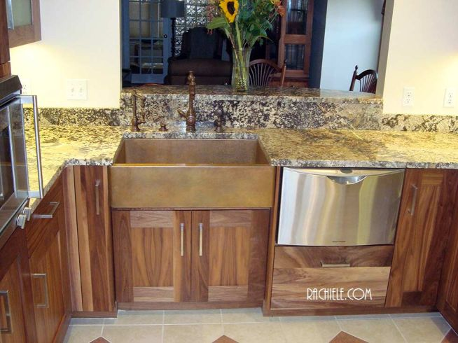 copper farmhouse sink with walnut cabinetry