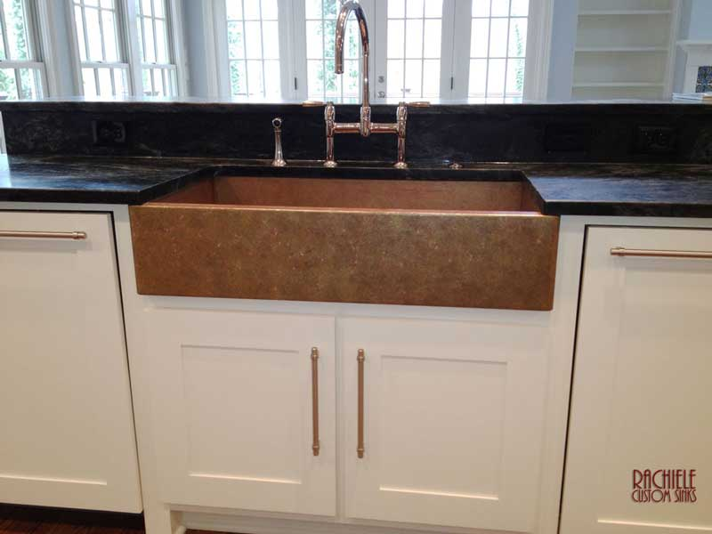 copper farm sink in white kitchen