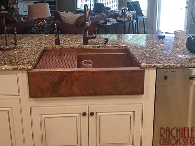 copper farmhouse workstation sink with copper drainboard