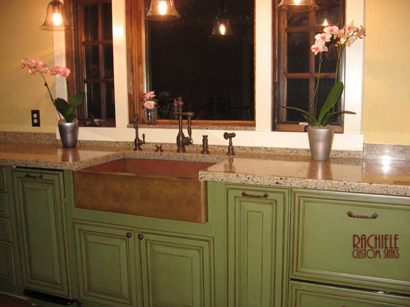 copper farm sink green cabinets