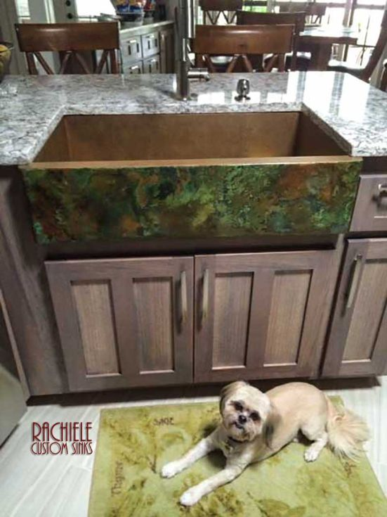 Copper farmhouse sink with green patina and dog