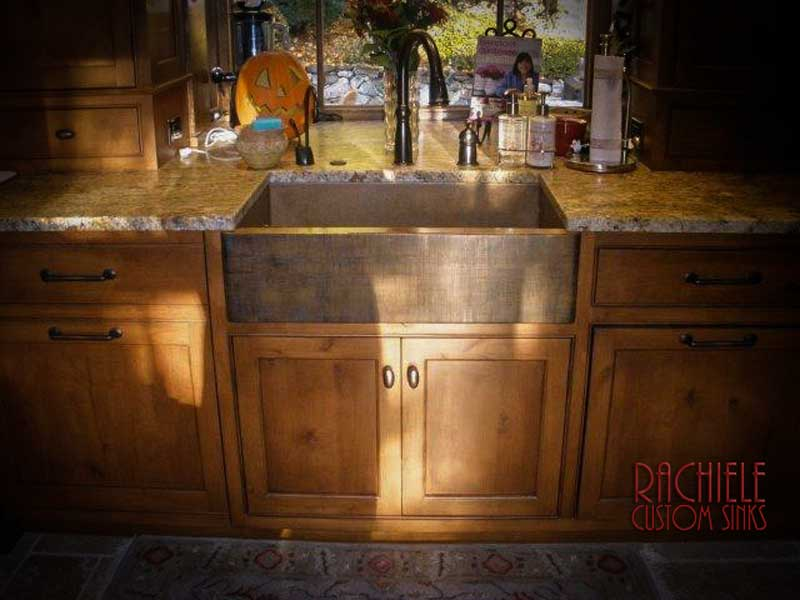 copper farmhouse sink with linen patina