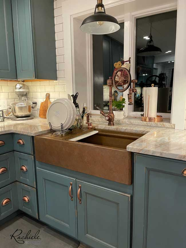 Copper workstation sink with Waterstone Wheel Faucet