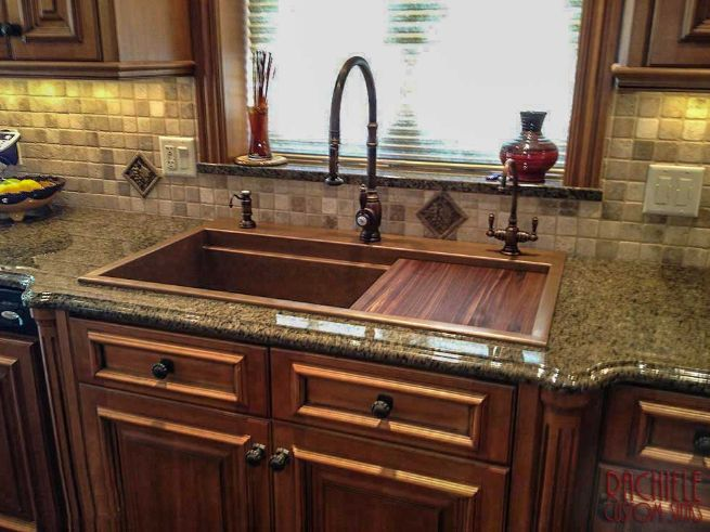 Copper top mount retrofit Signature Series kitchen workstation sink. This sink replaced a triple bowl sink