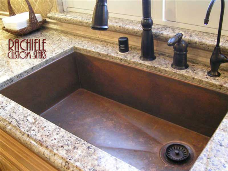 copper sink with trademark corner drain