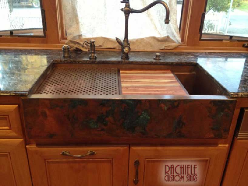 copper workstation farm sink with cutting board