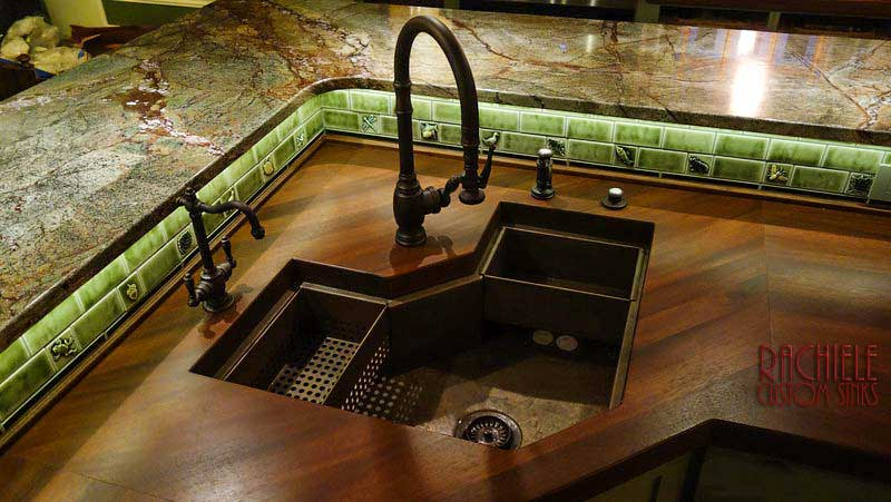 copper corner custom sink in mahogany counter top
