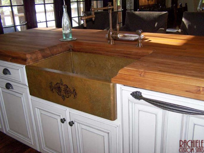 copper farm sink with stencil and walnut counter top