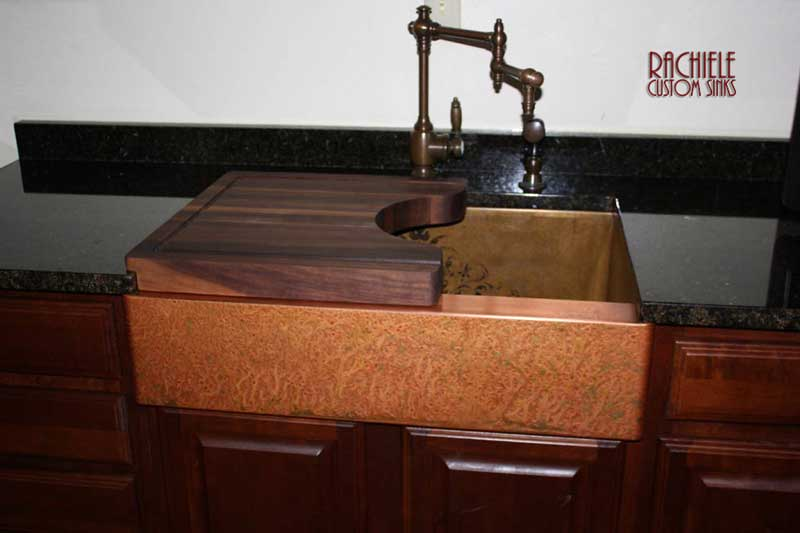 Copper sink with a custom American Black walnut cutting board and a waterstone Towson faucet