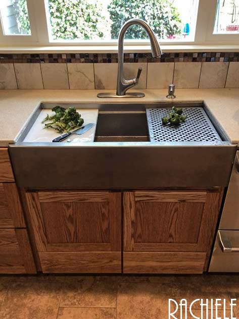 stainless kitchen farmhouse workstation sink with cutting board an grid drainer