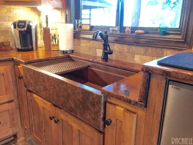 copper farmhouse sink with autumn patina