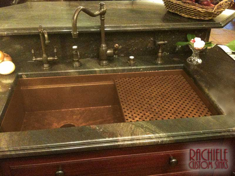 copper under mount sink designed for left handed users