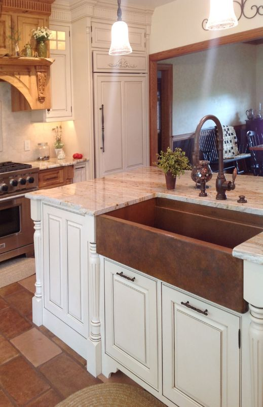 muted earth tone patina on a copper farmhouse sink