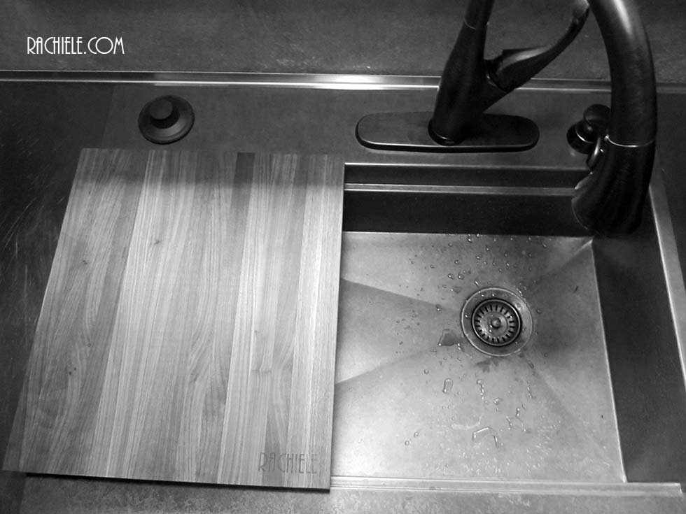 Black and white photo of cutting board with laser engraved logo