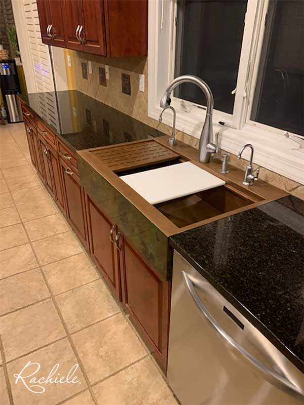 Copper retrofit farmhouse sink in existing cabinetry