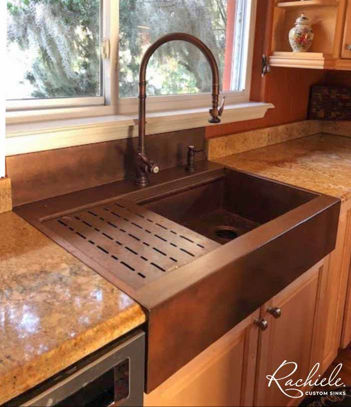 Copper top mount retrofit Signature Series kitchen workstation sink with integral backsplash..