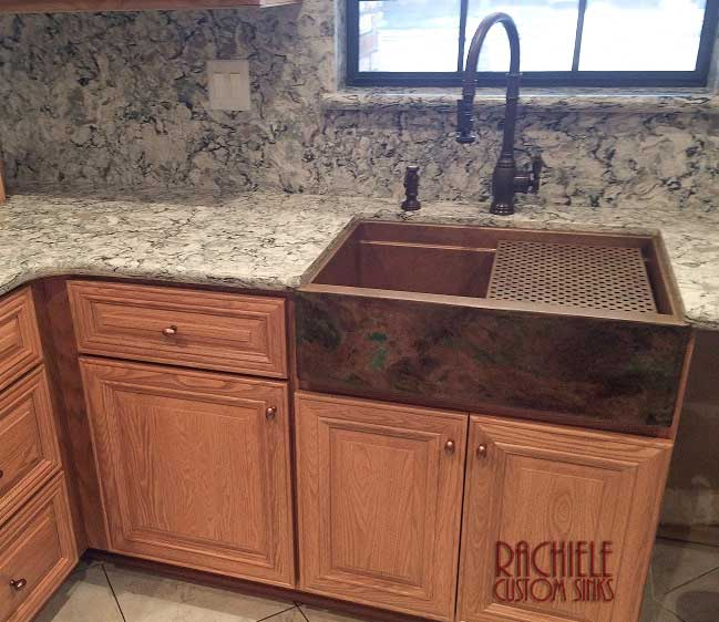 copper farmhouse sink with rustic patina