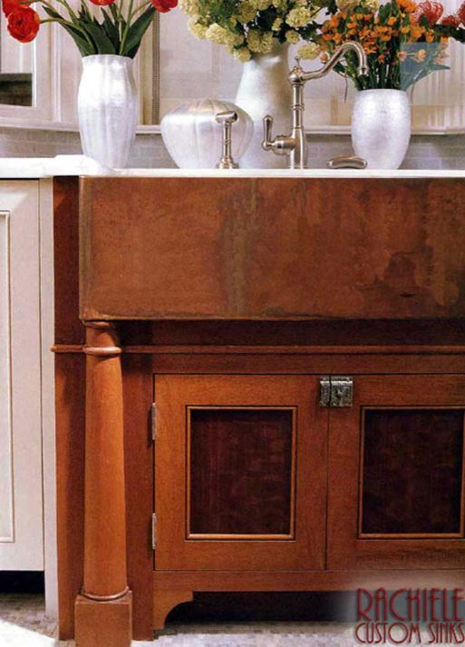 copper farmhouse sink with aged patina