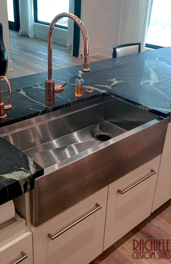 Farmhouse stainless workstation sink with copper faucet