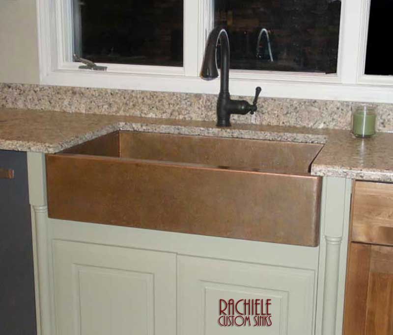 copper farmhouse sink with weathered patina
