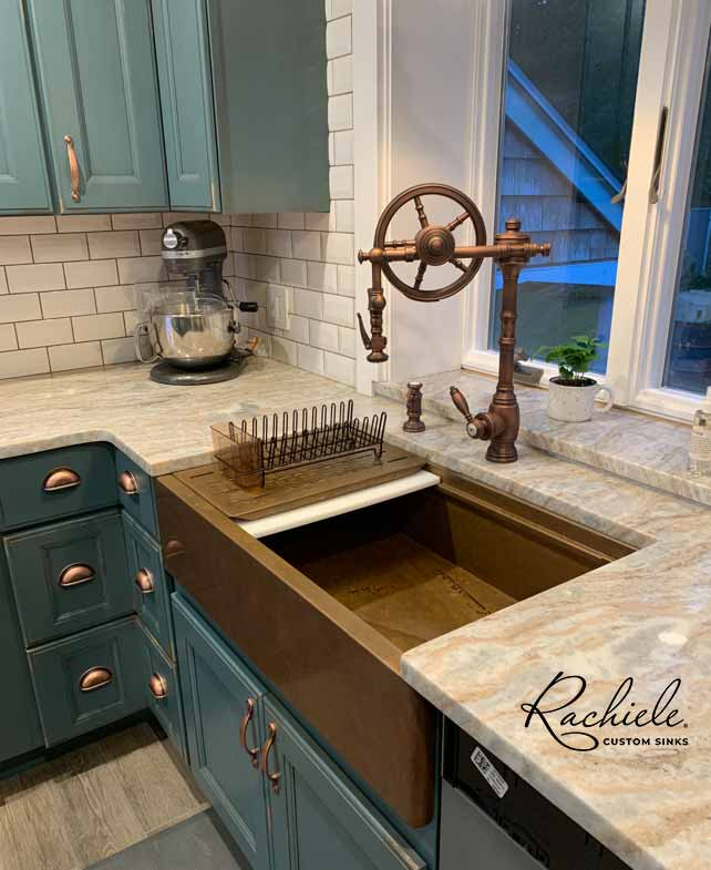 Copper workstation farmhouse sink with Waterstone Wheel Faucet