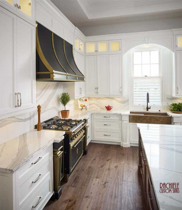 Large white kitchen with copper farmhouse sink