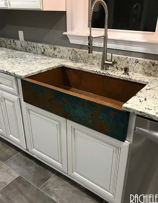 copper farm sink in a white kitchen