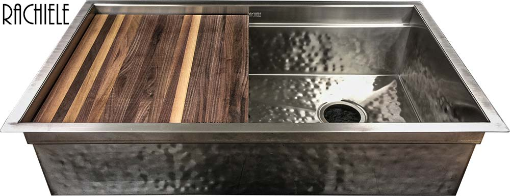 Hammered stainless under mount kitchen sink with integrated cutting board and drain grid.