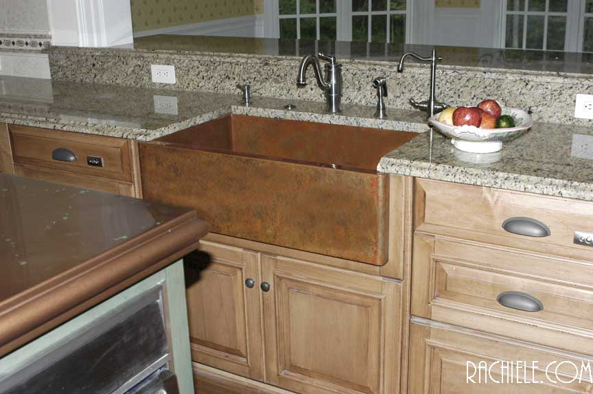 Copper Apron Front Sink With Weathered Patina In A Model Home For HGTV.