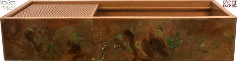 interior of a copper sink with a natural patina
