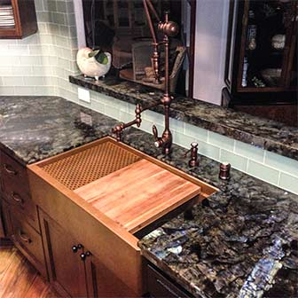 custom copper sink with cutting board