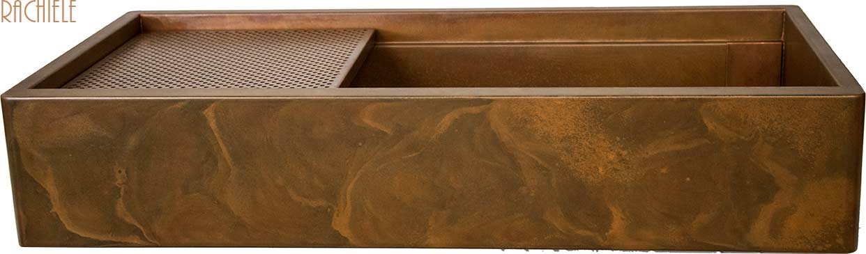 Copper farm sink with rustic earth tone patina