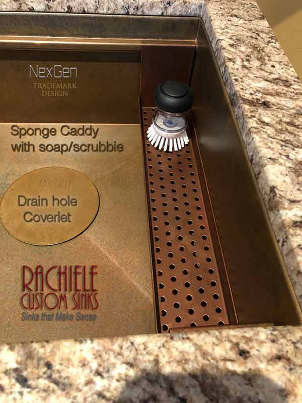 copper sponge caddy with scrubbie in a copper sink
